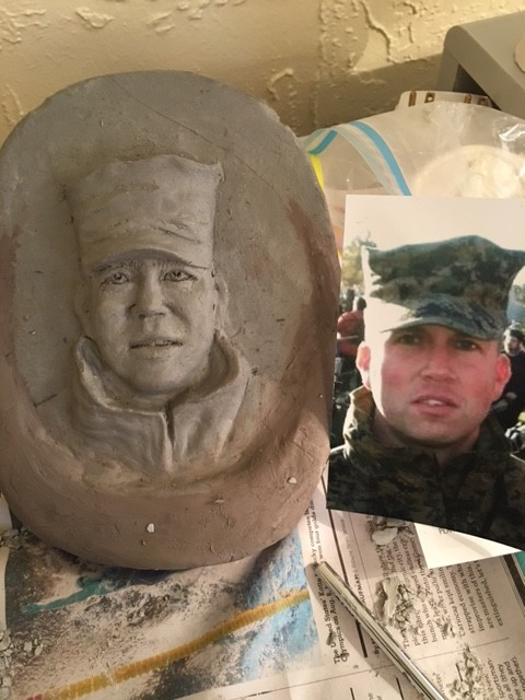 Clay portrait carving by Cathie Cordova Oldham